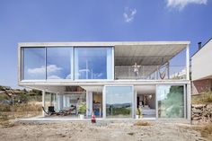 Spanish studio Narch has designed 'Calders House', a semi-transparent house lined with bay windows for a family in a small village in Catalonia.