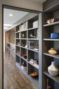 Kitchen, Rows Of Books Pottery Ceramics Vases Grey Shelves Decorated Room Connecting Rooms Modern Wood Flooring Kitchen Design Ideas Steel B. Kitchen Flooring, Wood Flooring, Grey Shelves, Futuristic Interior, Modern Kitchen Design, Modern Room, Cool Kitchens, Architecture Design, Room Decor