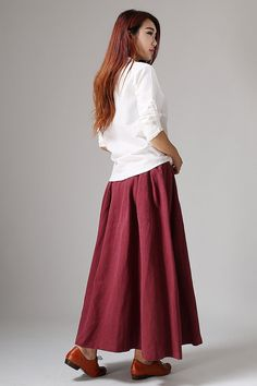 This is a long skirt for woman. Red linen skirt maxi skirt. There are two pockets on each side, there is a zipper in the right side. * Made from linen fabric * Two big pockets on each side * zipper closure * Maxi pleated skirt * Regular fit * More color and choise *