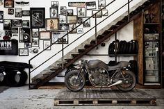 Modern, industrial, and manly Interior design. A gallery wall for the manliest of men. The slightly off kilter hanging of the art and hodge-podge pieces just makes the wall that much more engaging and intriguing.