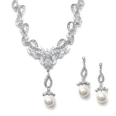 Linear CZ and Pearl Wedding Earrings $29.95 www.nuptialsboutique.com #bride #brides #wedding #weddings #weddingjewelry #jewelry #bridal jewelry #bridesmaidsgifts #earrings #silver #diamond #necklace #pearl
