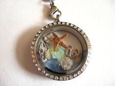 A true Nautical themed unique Floating Charm Locket Necklace on Etsy: https://www.etsy.com/listing/224341863/beach-memories-floating-charm-living?ref=listing-shop-header-2