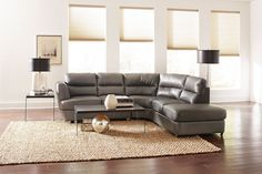 Contemporary leather sectional with a chaise and chrome legs.