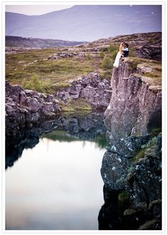Saw this on 100 Layer Cake, an Iceland Engagement shoot. BEAUTIFUL! Congrats to this couple! One day I'd love to go to Iceland, it's so fantastic and crisp.    cliff-edge lake view in iceland