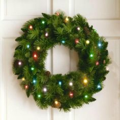 """36"""" Cordless LED Pre-Lit Christmas Wreath by Brookstone. $99.95. LED lights are bright, long-lasting and stay cool to the touch. 36"""" wide and cordless. A timer turns the lights on and off automatically.. Long, realistic needles and pinecones. All Wreaths use 6 C batteries (not included).. 36"""" Cordless LED Pre-Lit Christmas Wreath. A battery operated Christmas wreath lets you decorate anywhere--indoors and out. No plug? No problem! This Christmas wreath with battery operated light..."""