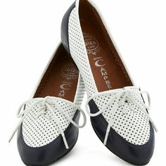 Jeffrey Campbell flats Cute perforated navy blue and white flats. Price reflects scuffs on the toes (see photos). Despite the slight imperfections, they have a lot of life left. Open to reasonable offers. Jeffrey Campbell Shoes Flats & Loafers