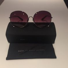 Marc by Marc Jacobs glasses Purple toned glasses. Never worn. In perfect condition. Comes with the box Marc by Marc Jacobs Accessories Glasses