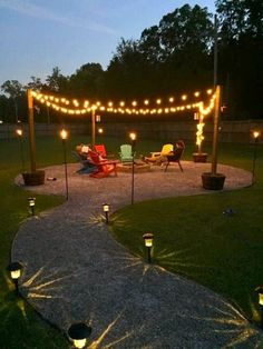 Love the lantern-lit path to the firepit, and lights strung up.