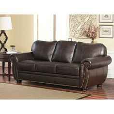 add a majestic sense of style to your living space with this rich brown leather sofa