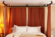 Canopy beds are more expensive than standard designs. Instead of buying a whole new bedroom set, get some fabric and some plumbing pipe to create a canopy that both classic and industrial.