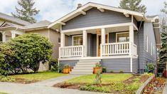 Grey Craftsman Style House With White Porch. Stock Image - Image of residential, architecture: 23908829