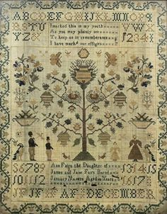 A George IV needlework sampler by Anne Fairs, dated 1828, 16ins x 13ins, in oak frame and glazed (some slight damage)