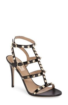 Free shipping and returns on Valentino Rockstud Sandal (Women) at Nordstrom.com. Valentino's signature gilded pyramid studs add edgy opulence to a strappy cage sandal shaped from glossy patent leather and lifted by a slim stiletto heel.