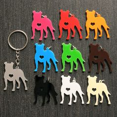 "Your color choice of a 1"" laser cut pit bull silhouette charm with a heart cutout on a key chain."