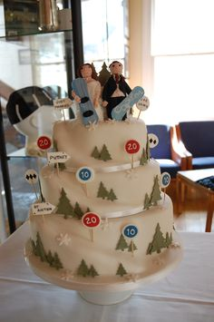 Four-tier snowboarding themed wedding cake with handmade figurines www.beautyandthebakery.co.uk