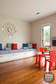 Here, the kids have their own space, colourfully decked out with Mammut table and chairs and Mala easel, both from Ikea. It can still be used as a chic space for entertaining.
