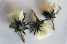 creamy ivory roses, given a rustic twist with thistles and twine.