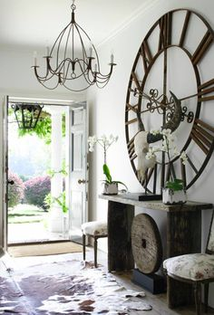 I chose this picture because of the giant clock. This room make good use of the limited space and has very interesting pieces. The light ficture is also interesting. The use of the natural light and natureness of this entry way helps create a very unique home kind of feeling.