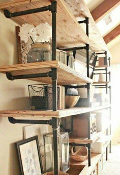Want to make those awesome industrial pipe shelves? Check out this helpful DIY tutorial on how to install industrial pipe shelves in your home. Industrial Pipe Shelves, Industrial House, Wood Shelves, Industrial Style, Industrial Design, Diy Pipe Shelves, Industrial Decorating, Industrial Office, Industrial Windows