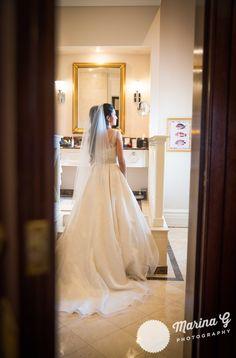 Bride getting dress moment