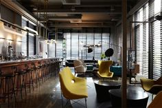 House Of Purple Hotel. Warm woods of bar facade with yellow gold and brass accent colours