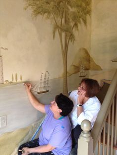 Artists Carol Kemery  and Mary Dima of Caromal Colours painting a Rufus Porter Style wall mural at Hydrangea Hill in Morrow Ohio.