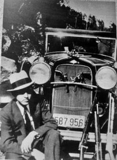"""Gangster Clyde Barrow with a Model A Ford car. Barrow and his accomplice were named """"Bonnie and Clyde""""."""