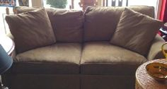 """Beautiful, nearly new, sleep sofa features beefy roll arms and plump down cushions and throws. Gray/beige (greige) ultra suede. 80"""" x 36"""". SOLD"""