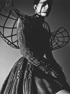 Textured coat & sculptural shoulder cage - 3D fashion; wearable art // fashion editorial for Numero Magazine