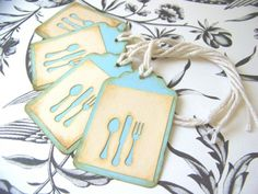 Silverware tags | Karboojeh Observation: 2 layers, piece of paper with flatware cutout, pasted onto a tag, with ink shading on the sides to give it a vintage look