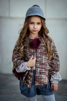 We love ponchos and capes from Amelie et Sophie.