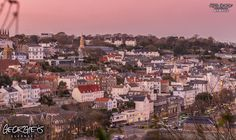 Interesting pink hue over St. Peter Port tonight as dusk fell. #GreatThings #LocateGuernsey  Link to the whole collection of 'Georgie's Guernsey' :-http://chrisgeorge.dphoto.com/#/album/4daaes  Picture Ref: 28_11_16 — in Guernsey.