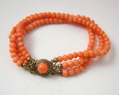 Triple Strand Genuine Coral Bead Bracelet with 800 Silver Clasp.