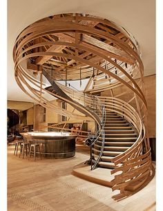 The Paris studio Jouin Manku fashioned this coiled wood staircase in the Haras Brasserie at Les Haras hotel in Strasbourg, France.