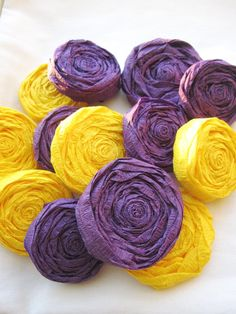 Lots you could do with these!  Paper Flower Rosettes  Purple and Gold LSU by http://www.IsleOfOwlie.etsy.com  set/20 $18.00
