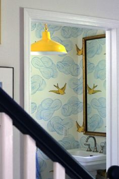 Gorgeous Hygge and West wallpaper and yellow pendant.