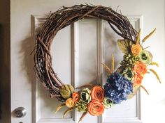 How to make fall decorations with this rustic wreath tutorial. Looking to brighten your fall door? Try this easy grapevine wreath tutorial.