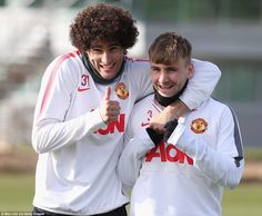 Manchester United duo Marouane Fellaini and Luke Shaw are all smiles ahead of their side's match against Arsenal