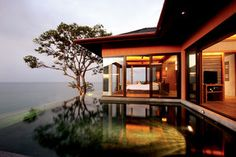 Sri Panwa Phuket  Prices From £150pp.  Sri panwa fuses glamour with a relaxed, trendy vibe. Simple, earthy tones and contemporary, soothing lines reflect a modern, chic style of living and the sumptuous villas all boast their own infinity-edge swimming pool complete with jet-stream Jacuzzi system. Perched high atop Cape Panwa with a stunning beach just beneath, it is an oasis of luxury and the perfect place to chill with friends and family.  Call Our Experts: 0871 811 1594
