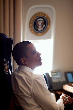 Barack Obama ponders the nation's future on Air Force One.