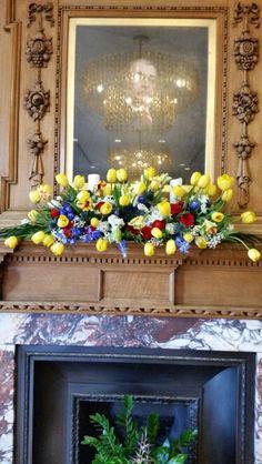 Colourful fresh flower fireplace arrangements