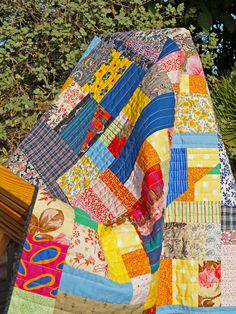 Bright and bold, a handmade, improvised lap quilt by André Morand. $400