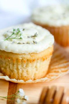 Lavender Vanilla Cupcakes with Honey Buttercream. Light and airy vanilla cupcakes made with real vanilla bean and lavender underneath a layer of almond and honey buttercream. They're almost (almost!) too fancy to eat.
