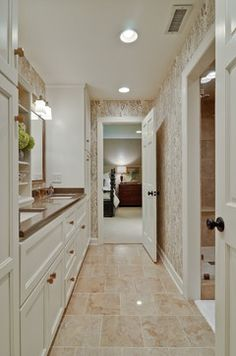 Double Sink Design Ideas, Pictures, Remodel, and Decor - page 83. Cabinet between sinks, plus tall cabinet at end.