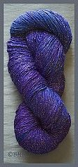 Rayon/Metallic yarn from Blue Heron yarns. Just finished a scarf in a color close to this. Love it!