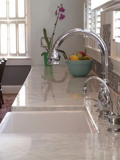 White pearl granite looks similar to marble but without the pitfalls of marble countertops.