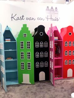 """Historic Amsterdam canal houses are the inspiration for these charming """"storage houses"""" by Kast van een Huis. The brightly colored cupboards, available in any configuration, would be an enchanting addition to a child's room — or even my guest room!"""