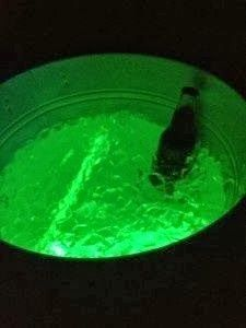 Great Idea!!! Throw a few ziplock bags w/ glow sticks in them in the bottom of beverage bins. /DIY Halloween Party Decor & Ideas | The Money-Saving Garden