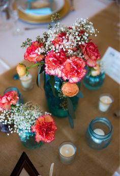 We love these cute bright florals in darling blue mason jars, perfect for any event! See more pretty event design from The Majestic Vision here. http://www.weddingchicks.com/vendor-guide/the-majestic-vision/