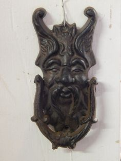 """A great heavy feeling door knocker. This cast iron door knocker is hand painted. Bring a nice vintage chram to any setting. The knocker measures 6 1/2"""" Tall x 3 1/4"""" Wide x 3 1/4"""" Deep. A brand-new, u"""